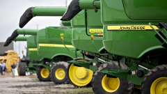 Deere & Co. John Deere combine harvesters sit on display during the Farm Progress Show in Boone, Iowa, U.S., on Tuesday, Aug. 28, 2018. The show, sponsored by Farm Progress Co. and owned by Penton Media, is billed as the largest outdoor farm show in the U.S.