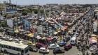 Heavy automobile traffic passes by Makola market in Accra, Ghana, on Thursday, March 15, 2018. Ghana wants to shake up the way it collects tax with the International Monetary Fund telling the government that it's not raising sufficient income.