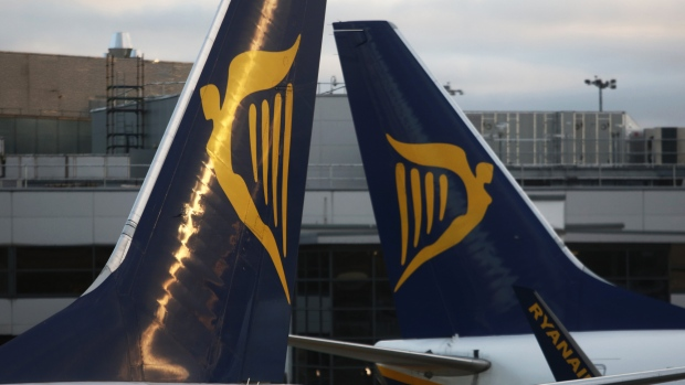Tail fins of Ryanair Holdings Plc aircraft stand next to each other at Dublin Airport, operated by Dublin Airport Authority, in Dublin, Ireland, on Friday, Nov. 25, 2016. Ryanair provides low fare passenger airline services to destinations in Europe.