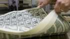 A pressman aerates a stack of 2017 50 subject uncut sheet of $1 dollar notes at the U.S. Bureau of Engraving and Printing in Washington, D.C.
