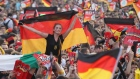 BERLIN, GERMANY - JUNE 28: Fans wave German flags at the Fanmeile public viewing at Brandenburg Gate prior to the Germany vs. Italy UEFA Euro 2012 semi-finals match on June 28, 2012 in Berlin, Germany. (Photo by Sean Gallup/Getty Images)