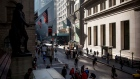 Pedestrians walk near the New York Stock Exchange.