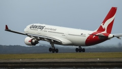 An Airbus SE A330-300 aircraft operated by Qantas Airways Ltd. takes off from Sydney Airport in Sydney, Australia, on Tuesday, Feb. 20, 2018. Qantas reports first-half results on Feb. 22 and has said profit may rise as much as 12 percent.