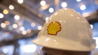 The Shell logo sits on a protective hard hat at the Royal Dutch Shell Plc lubricants blending plant in Torzhok, Russia, on Wednesday, Feb. 7, 2018. The oil-price rally worked both ways for Royal Dutch Shell Plc as improved exploration and production lifted profit to a three-year high while refining and trading fell short of expectations as margins shrank.