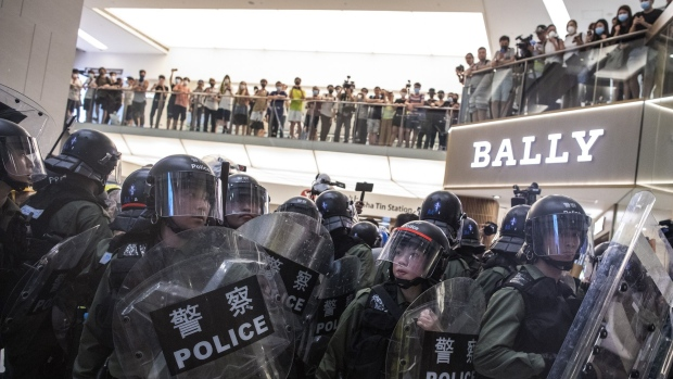 Police stand off against demonstrators inside New Town Plaza shopping mall during a protest in Hong Kong on July 14.