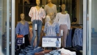 Clothing is displayed for sale inside a Gap Inc. store on the Third Street Promenade in Santa Monica, California.