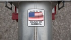 "A ""Made In The Heart Of America"" sticker is displayed on grain loading equipment on display during the Farm Progress Show in Boone, Iowa, U.S., on Tuesday, Aug. 28, 2018. The show, sponsored by Farm Progress Co. and owned by Penton Media, is billed as the largest outdoor farm show in the U.S."