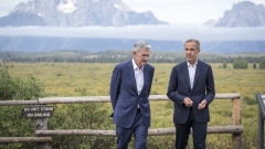 "Jerome Powell, chairman of the U.S. Federal Reserve, left, and Mark Carney, governor of the Bank of England (BOE), walk the grounds during the Jackson Hole economic symposium, sponsored by the Federal Reserve Bank of Kansas City, in Moran, Wyoming, U.S., on Friday, Aug. 23, 2019. Powell said the U.S. economy is in a favorable place but faces ""significant risks,"" reinforcing bets for another interest-rate cut next month though the remarks failed to mollify President Donald Trump. David Paul Morris/Bloomberg"
