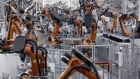 Robots weld car body components for vehicles at the Bayerische Motoren Werke AG (BMW) Manufacturing Co. assembly plant in Greer, South Carolina, U.S. on Thursday, May 10, 2018. Markit is scheduled to release manufacturing figures on May 23.