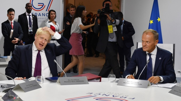 BIARRITZ, FRANCE - AUGUST 25: Britain's Prime Minister Boris Johnson and European Council President Donald Tusk meet for the first working session of the G7 Summit on August 25, 2019 in Biarritz, France. The French southwestern seaside resort of Biarritz is hosting the 45th G7 summit from August 24 to 26. High on the agenda will be the climate emergency, the US-China trade war, Britain's departure from the EU, and emergency talks on the Amazon wildfire crisis. (Photo by Jeff J Mitchell - Pool /Getty Images)