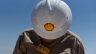 "A logo is displayed on the hardhat of a worker at the Royal Dutch Shell Plc processing facility in Loving, Texas, U.S., on Friday, Aug. 24, 2018. Royal Dutch Shell Plc came through a quarter of volatile oil prices to beat earnings estimates, delivering a surge in cash flow the company said will underpin ""world-class"" returns to investors."
