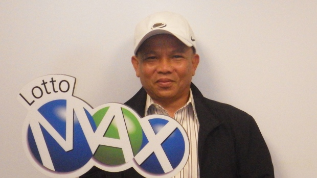 Bon Truong, who won $60-million in a Lotto Max draw, poses in St.Albert, Alta. on Wednesday, Aug.28.