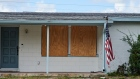 A house with windows protected by plywood stands ahead of Hurricane Dorian in Cocoa Beach, Florida