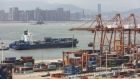 A container ship passes in front of containers and gantry cranes at the Haitian Container Terminal, operated by the Xiamen Port Authority, in Xiamen, China, on Monday, Aug. 26, 2019. After a weekend of confusing signals, only a few negotiators in Beijing see a deal possible ahead of the 2020 U.S. election, in part because it's dangerous to advise President Xi Jinping to sign a deal that Trump may eventually break, according to Chinese officials familiar with the talks who asked not to be identified.