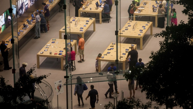 Shoppers look at products at the Upper West Side Apple Inc. store in New York.