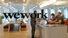 Signage is seen at the entrance of the WeWork Cos Inc. 85 Broad Street offices in the Manhattan borough of New York, U.S., on Wednesday, May 22, 2019. WeWork has become the biggest private office tenant in London, Manhattan and Washington on its way to 425 office locations in 36 countries overall.