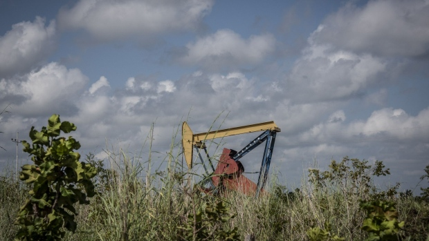 A pump jack stands at a Petroleos de Venezuela SA (PDVSA) Petropiar facility in El Tigre, Venezuela, on Sunday, Oct. 14, 2018. State-owned PDVSA doesn't publish statistics, but environmentalists and analysts keep seemingly endless lists of examples of wayward crude - unleashed by busted valves, ripped gaskets, and cracked pipes - that they say has polluted waterways and farmland and probably has seeped into the nation's aquifers.