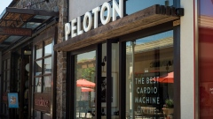 "A Peloton Interactive Inc. store stands in Corte Madera, California, U.S., on Thursday, Aug. 29, 2019. Founded in 2012, Peloton describes itself as the ""largest interactive fitness platform in the world"" with more than 1.4 million members, according to its filing."