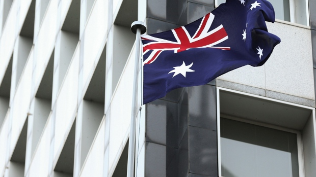 The Australian flag flies outside the Reserve Bank of Australia (RBA) headquarters in Sydney, Australia, on Monday, Dec. 4, 2017. Australia\'s central bank is on track for its longest stretch of unchanged interest rates as it bets a tightening job market will begin to put upward pressure on wages -- at some stage.