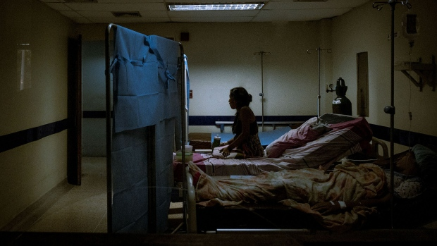 Women lay in a converted medical room inside the Ana Teresa de Jesus Ponce maternity hospital in Macuto, Venezuela