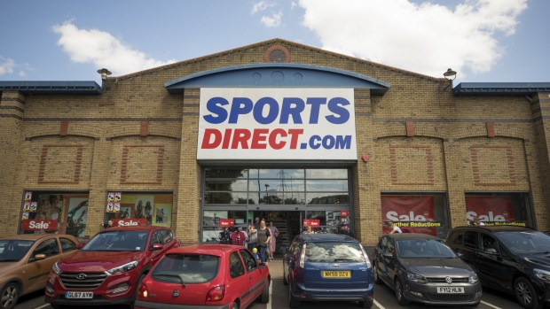 An automobile reverses from a parking space outside a Sports Direct International Plc store in Crayford, U.K. on Monday, July 29, 2019. Sports Direct plunged after the U.K. retailer reported a surprise tax bill of almost $750 million, the departure of its financial chief and deepening woes at department-store chain House of Fraser.