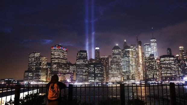 NEW YORK, NY - SEPTEMBER 11: The 'Tribute in Light' memorial lights up lower Manhattan near One World Trade Center on September 11, 2018 in New York City. The tribute at the site of the World Trade Center towers has been an annual event in New York since March 11, 2002. Throughout the country services are being held to remember the 2,977 people who were killed in New York, the Pentagon and rural Pennsylvania in the terrorist attacks on September 11, 2001. (Photo by Spencer Platt/Getty Images)