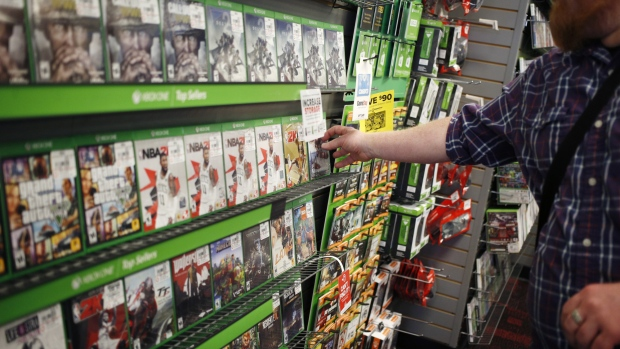 An employee arranges Microsoft Corp. Xbox One video games inside a GameStop retail store in Louisville, Kentucky, U.S., on Thursday, March 15, 2018. GameStop Corp. is scheduled to release earnings figures on March 28.