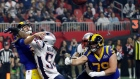 New England Patriots' Dont'a Hightower (54) hits Los Angeles Rams' Jared Goff, left, as he throws a