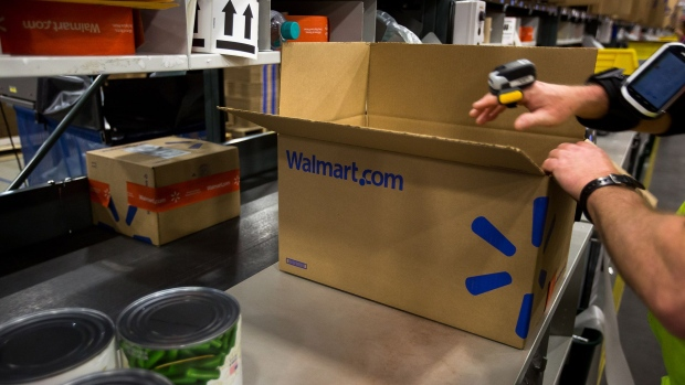 An employee packages products inside a Wal-Mart Stores Inc. fulfillment center in Bethlehem, Pennsylvania.