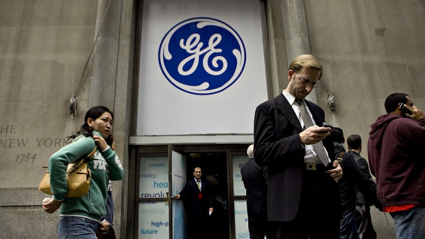 A General Electric Co. logo hangs above the entrance to a building where a GE news conference was being held in New York, U.S., on Wednesday, Oct. 21, 2009.