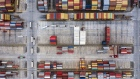 Shipping containers sit stacked at the Yangshan Deepwater Port, operated by Shanghai International Port Group Co. (SIPG), in this aerial photograph taken in Shanghai, China, on Friday, May 10, 2019.