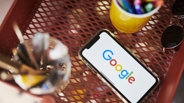 The Google Inc. logo is displayed on an Apple Inc. iPhone in this arranged photograph taken in the Brooklyn borough of New York, U.S., on Friday, July 19, 2019. Alphabet Inc. is scheduled to release earnings figures on July 25.