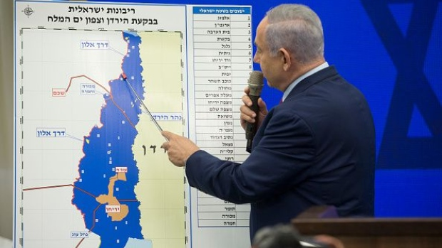 RAMAT GAN, ISRAEL - SEPTEMBER 10: Israeli Prime Minster Benjamin Netanyahu points to a Jordan Valley map during his announcement on September 10, 2019 in Ramat Gan, Israel. Netanyahu pledges to annex Jordan Valley in Occupied West Bank if Re-Elected on SEPTEMBER 17th Israeli elections. (Photo by Amir Levy/Getty Images)