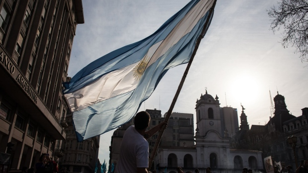A demonstrator waves an Argentinian flag during a rally on the one-month anniversary of the disappearance of activist Santiago Maldonado in Buenos Aires, Argentina, on Friday, Sept. 1, 2017. Maldonado disappeared during a protest, when police detained a group of Mapuche Indians, demanding the release of a jailed Mapuche leader.
