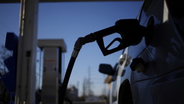 A gasoline pump nozzle refuels a sport utility vehicle (SUV) at the B&N Food Market gas station in Bagdad, Kentucky, U.S., on Wednesday, Feb. 26, 2014. The national unleaded average gasoline price rose to $3.436 per gallon yesterday, according to AAA.