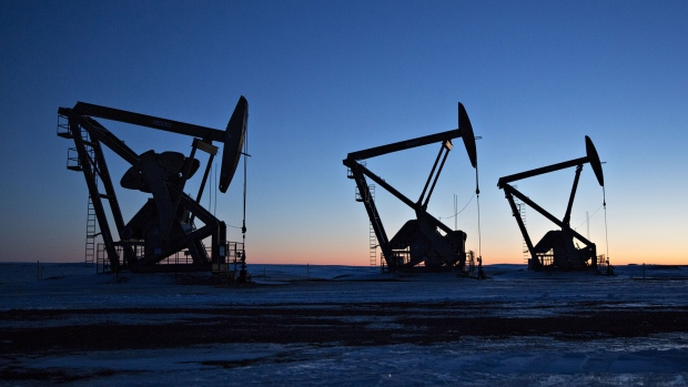 The silhouettes of pumpjacks are seen above oil wells in the bakken formation near dickinson north dakota u s on wednesday march 7 2018