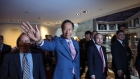 Terry Gou, former chairman of Foxconn Technology Group, center, waves as he walks with Michael Marks, chairman of Katerra Inc., left, and Masayoshi Son, chairman and chief executive officer of SoftBank Group Corp., during the G2 and Beyond Conference in Taipei, Taiwan, on Saturday, June 22, 2019. Gou, stepped down as Hon Hai chairman on June 21 to focus on winning a party nomination to compete in the 2020 Taiwanese presidential elections, had run a company that depends on Apple for half its revenue. Photographer: Billy H.C. Kwok/Bloomberg