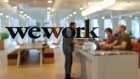 Signage is seen at the entrance of the WeWork Cos Inc. 85 Broad Street offices in the Manhattan borough of New York. Photographer: David 'Dee' Delgado/Bloomberg