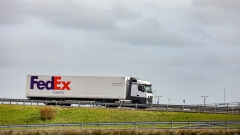 A cargo truck, operated by FedEx Corp., travels on a highway near the French border in Calais, France, on Monday, March 18, 2019. French cabinet last month approved a decree that would keep Eurostar trains running through Eurotunnel's Channel tunnel in the case of a so-called Hard Brexit.
