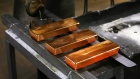 Three red hot gold ingots cool after being removed from casting molds by a worker in the foundry at the JSC Krastsvetmet non-ferrous metals plant in Krasnoyarsk, Russia, on Friday, March 3, 2017. Krastsvetmet refines and releases nonferrous metals.