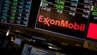 A monitor displays Exxon Mobil Corp. signage on the floor of the New York Stock Exchange (NYSE) in New York, U.S., on Friday, Feb. 9, 2018. The convulsions rocking U.S. equity markets continued Friday, with major indexes headed for the worst week in almost seven years after falling back from early gains. Treasury declines eased as investors sought havens from gold to the yen.