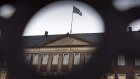 A flag flies above the headquarters of Danske Bank A/S in Copenhagen, Denmark, on Tuesday, Sept. 18, 2018.