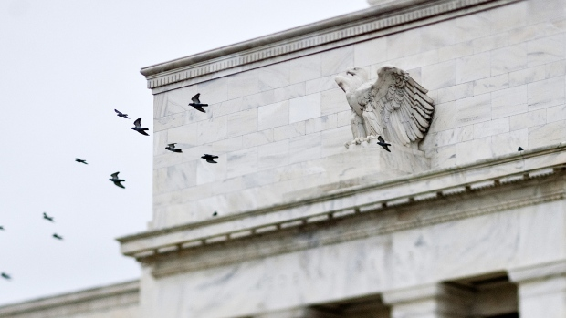 Birds fly past the Marriner S. Eccles Federal Reserve Board building in Washington, D.C.