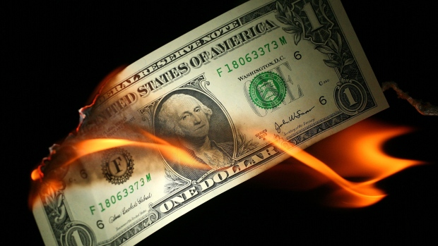 GETTY IMAGES - In this photo illustration, an America one USD note burns, October 24, 2008, Manchest