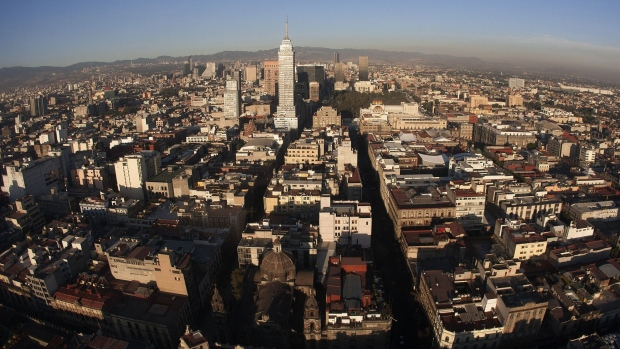 The Latin American Tower, center, stands in the city skyline in this aerial photograph taken from a helicopter in the Condor Group, a fleet of helicopters operated by the Federal District Secretariat of Public Security, in Mexico City, Mexico, on Friday, Feb. 15, 2013.