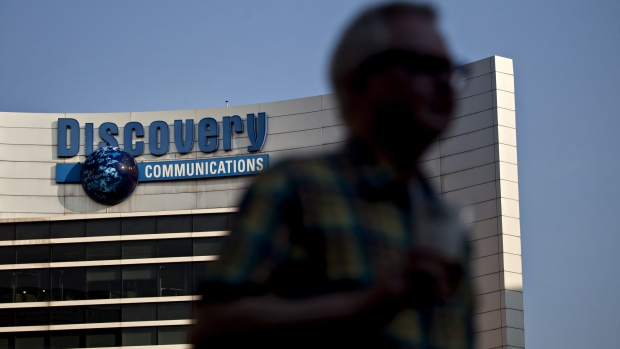 A pedestrian passes in front of Discovery Communications headquarters in Silver Spring, Maryland.