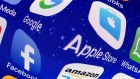 In this photo illustration, logos of the Google, Apple, Facebook, and Amazon applications (GAFA) are displayed on the screen of an Apple iPhone on May 31, 2018 in Paris, France.