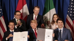 The presidents of Mexico, the U.S. and Canada sign USMCA in November 2018