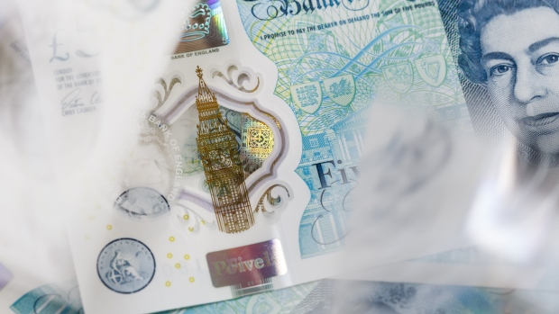 The Elizabeth Tower, also known as Big Ben, is seen on a British five pound banknote, in this arranged photograph in London, U.K., on Thursday, Oct. 13, 2016.