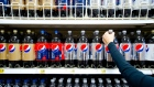 A shopper reaches for a bottle of PepsiCo Inc.'s Diet Pepsi soda in a grocery store in Atlanta, Georgia, U.S., on Tuesday, Feb. 7, 2012.